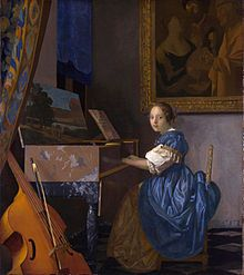 Vermeer's Lady Seated at a Virginal, in which The Procuress hangs on the wall behind the figure