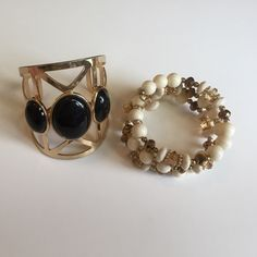 Black and gold cuff & 3 layer beaded bracelet Gold and black cuff. Cream and gold beads. Stretches to fit any size wrist. Both worn once. Both look brand new Jewelry Bracelets