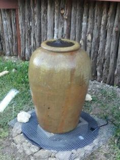"Here is a great, 1/2 day DIY project that looks amazing. Put in a disappearing fountain. Find a suitable sized pot and a location. Get a small basin from a home improvement store or your local nursery and dig a hole 2 in"" larger than the diameter of the basin. Make sure it is level and backfill with the dirt from the hole. Get an inexpensive connection kit and a small pump. Place the pot on a cinder block, check for level, assemble the connection kit to the pot and the pump, fill w/water, enjoy!"