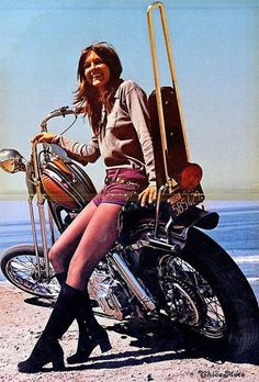 70's style chopper nice sissy bar.  Girls,bikes and sand 70's were COOL!