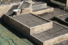 preparing boxes for squarefoot planting. I used a ruler with a raised middle, upside-down, to create the lines.