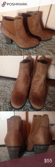DSW Suede brown booties, never worn before!! Black line in front is the only scuff, besides that great condition!! Size 8 Dsw Shoes Ankle Boots & Booties
