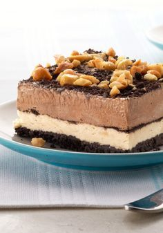Peanut-Chocolate Mud Pie Squares – This chilled mud pie recipe is stacked with chocolate pudding and peanut butter fluff for a crunchy, creamy, icy take on a restaurant dessert favorite.