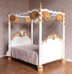 Ornate beautifully carved four poster cherub bed in gold and white.