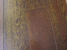 A spectacular and unusual floor, this gold inlayed oak is perfect for any sized contemporary room. A varnished dark oak with a gold sparkled grain