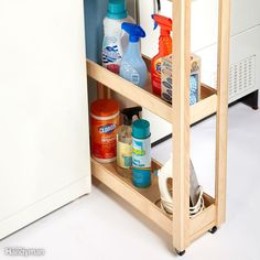 A lot of laundry rooms have a narrow wasted space either next to or between the washing machine and dryer, and it's usually a hideout for socks and lint. To take advantage of this space, build a simple plywood cart on fixed casters to hold detergents and other laundry supplies. Get more easy organizing ideas.