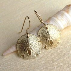 Sand Dollar Earrings - These look just like the necklace my grandmother left me, and the inspiration for the tattoo on my back.