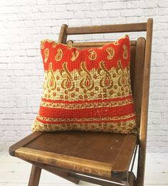 "Paisley Kantha Cushion - Handcrafted by women at a co-op in Bangladesh. Kantha meaning 'patched cloth', offers a glimpse into the creativity and artistry of Bengali women.  Young women in Bangladesh are at great risk of being sold into trafficking and are often discarded by husbands or families when they are deemed ""expendable.""  The co-op's vision is help these women rediscover their dignity and inherent value not only through meaningful work, but also by welcoming them as part of their…"