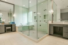 Dual-headed glass and tile steam shower