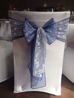 Navy blue. & white lace chair sash
