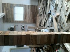 Take about 15 random colored pallets break them down and nail the boards to your wall to get a nice rustic wood wall.