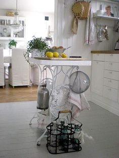 Old cast iron sewing machine table converted to kitchen island.