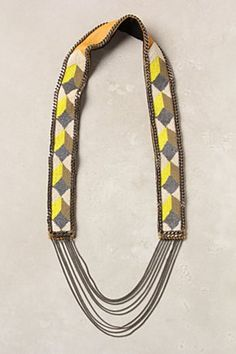 canary geometry necklace, €423  A beaded matrix of color pops is linked by slim brass strands. By Fiona Paxton.  Leather, brass, cotton, glass  48cm L, 4cm W