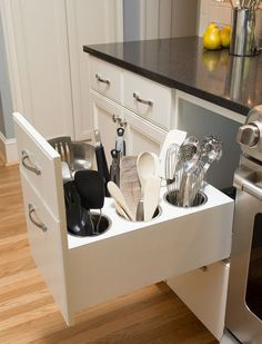 Finally, a smart solution for messy utensils. Instead of containers stuffed with spatulas cluttering your counter, this nifty drawer keeps 'em at the ready, yet out of sight.