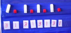 AAAB pattern with linking cubes.  They linked together the cubes to show the number patterns.  I like how the repeating parts are identified by quanities.
