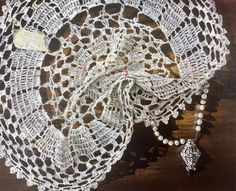 Artist Lindsay Arnold has a series of paintings featuring doilies, filled with emotion, history and meaning