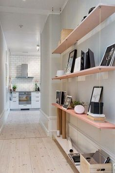 Suspend shelves in a narrow hallway for added storage and display space.