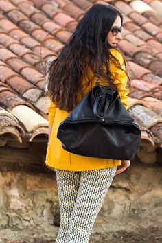 Black leather backpack and Yellow Peacoat  More pics and details on my blog:  http://www.withorwithoutshoes.com/2014/10/chaqueton-marinero-amarillo-yellow-peacoat.html  #yellow #peacoat #backpack #leather #sunglasses #prada @blackfive