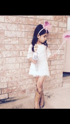 Toddlers looks fabulous in lace dresses and cowgirl boots.  Kids fashion