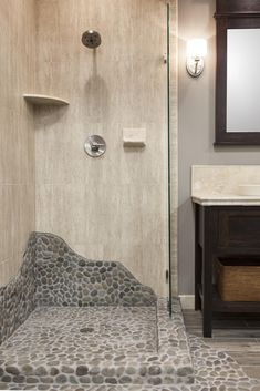 This shower brings elements of nature with a shower pan tiled with pebble mosaic. click the image for more details. Pebble Floor, Pebble Mosaic, Ceramic Floor Tiles, Stone Shower Floor, Pebble Tile Shower, Cozy Bathroom, Small Bathroom, Mosaic Bathroom, Modern Bathrooms