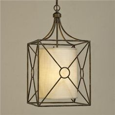 Riviera Iron Lantern A classic iron design gets an updated twist with a cream linen shade hanging inside, showcasing the quality design and golden-bronze finish. 6 of chain.  3x60 watts (candle sockets). (24Hx12W) Inside Shade: 11Hx9W  Product SKU: LA09006 BZ Price: $455.00