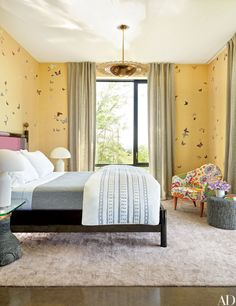 De Gournay wallpaper, printed with butterflies, lines the daughter room.