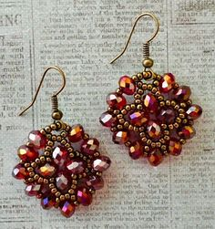 "NUNZIA'S EASY EARRINGS   11/0 seed beads Miyuki ""Dark Bronze"" (11-457D)  6mm rondelles ""Crimson AB"" (Chinese)    I've made the single a..."