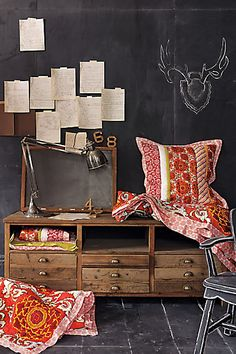 who doesn't NEED a chalkboard wall?? I know I do...this would be amazing for a mud room entrance.  I would switch that pillow and blanket for a quilt and a large burlap pillow though...
