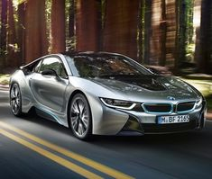 BMW unveils the production i8, a hybrid supercar to challenge Porsche and Ferrari- In other words- they released a beast.