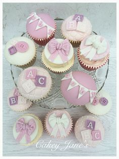 Pink-for-a-girl Baby Shower cupcakes; bunting, blocks, buttons and bows theme