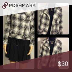 Wool black and white fitted jacket with zipper NWOT jacket with silver threads gunning through pattern for a little sparkle. Zipper up front and on sleeves. Size small, fits more like XS but has room for turtleneck underneath. Dresses up simple black skirt or jeans Matty B Jackets & Coats Blazers