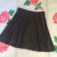 """H&M Black Polka Dot Skater Skirt Really nice quality black with mini polka dots skater skirt from H&M. Only worn and washed once - in EUC! Fabric is a poly/elastane blend. Elastic waist pull on style. Waist - 28""""-30"""" / length 19"""". H&M Skirts Circle & Skater"""