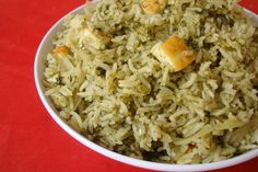 There are probably a dozen ways to prepare spinach rice. This particular recipe is very simple, flavorful and quick to make. Mildly spiced with warm flavors, this green colored rice makes for a lovely one pot meal.