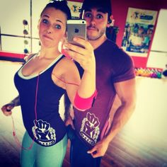 Fitness couple proudly wearing the Bia fist!