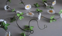 FISHERS4FLOWERS 6FT 7`` SILK FLOWER DAISY GARLAND/WEDDING FLOWERS/DECORATION/CRAFTS 1XPIECE 6FT 7 DAISY GARLANDIDEAL FOR WEDDINGS AND GENERAL CRAFTTHEY ARE READY FOR IMMEDIATE DISPATCH NO NEED TO WAIT.WE HAVE THESE ALREADY MADE UP FOR US.AND AREEXCL (Barcode EAN = 5060295311552) http://www.comparestoreprices.co.uk/silk-flowers/fishers4flowers-6ft-7-silk-flower-daisy-garland-wedding-flowers-decoration-crafts.asp
