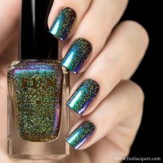 Holographic nail polish of green, blue, violet, red and a little bit of gold for a sparkling manicure. Fully opaque in 2-3 coats! Collection: New Year 2015 Collection