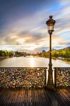 """The most perfect place in the world: Pont des Arts/ the Love Lock Bridge in Paris!   """"Couples writes their names & special date on a padlock and locks it onto the bridge. They make a wish and then throw the key into the Seine River as a symbol of their undying and everlasting love"""""""