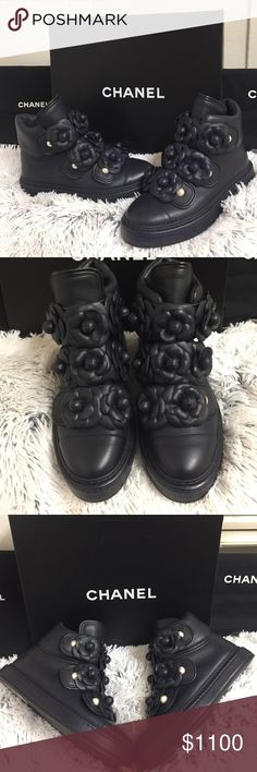 Chanel Lambskin Leather HighTop Sneaker Camellia 💯AUTHENTIC. ✨BRAND NEW WITH TAGS AND DUSTBAGS✨ CHANEL Navy Lambskin Leather Camellia Flower High Top Sneaker Boots. These Have A Stunning Soft Lambskin Leather Feel With Beautiful Flower Detail. It Contains Buttons And Pearl Gold Logo. Never Worn. Purchased In Barney's New York. Size 35. Original Price: $1,650 CHANEL Shoes Sneakers