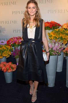 Olivia Palermo wearing Aquazzura + Olivia Palermo Cutout Leather Sandals, Piperlime Faux Leather Midi Skirt and Jeffrey Levinson Snow Leopard Clutch.