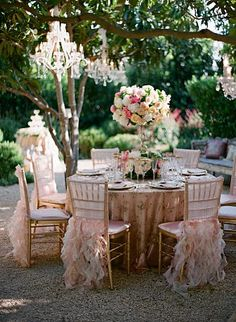Outdoor chandeliers and feathers - of course!