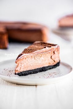 This Triple Chocolate Mocha Cheesecake combines a buttery chocolate wafer crust topped with the creamiest chocolate espresso cheesecake filling, followed by the final layer—a decadent dark chocolate ganache that's poured all over the top! And the very best part? NO WATER BATH IS NEEDED! | BeyondtheButter.com | #cheesecake #chocolate #beyondthebuter #espresso