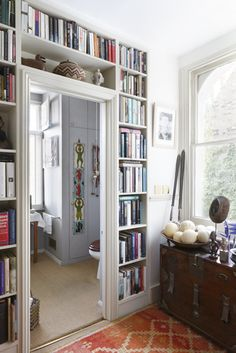 i have no place in my house for a book shelf, then I had an amazing idea!...perfect for my living room. even has a little window bench right next to the doorway. def doing this.