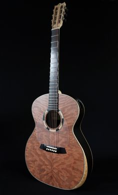 David Antony Reid VaultBack, steel string acoustic guitar. African Blackwood, birdseye maple and 100 year old curly sequoia.