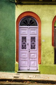 Old lilac door in Montevideo, Uruguay by Viviane Nathan