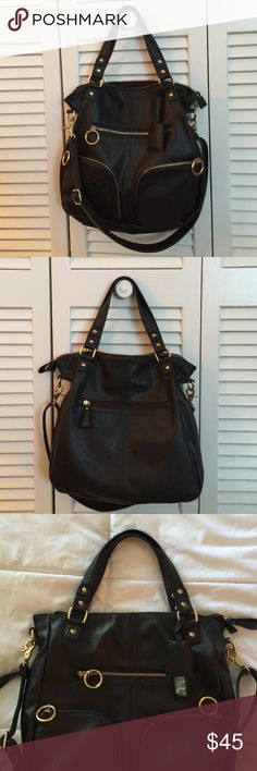 Urban outfitters deems & ozzy bag This bag's got it going on! Gorgeous gold hardware, lots of organization and a few options to carry- double handles and adjustable long strap. Very clean and smoke free. No issues. Cute mirror on outside to discreetly check yourself ;) not leather but looks like it. Always get compliments when I carry this bag.  Works well with any outfit! Deena & Oozzy Bags