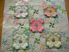 Dogwood flower quilt that Emi M. stitched all by hand - stunning!