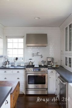 Eclectic Home Tour House No. 214 - Love the white subway tile going to the ceiling and the bead board ceiling - every detail of this house is gorgeous! eclecticallyvintage.com
