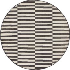 "This Turkish Tribeca rug is made of Polypropylene. This rug is easy-to-clean, stain resistant, and does not shed. Colors found in this rug include: Black, Ivory. The primary color is Black. This rug is 1/4"" thick for a flat-weave look."