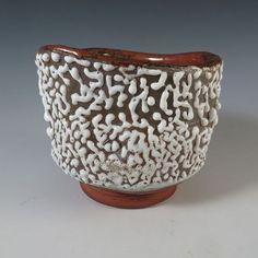 Glazy.org recipe John's Beads, Cone 6 / 75 NS, 20 magn.carbonaat (licht), 3 ball clay, 2 zinkoxide