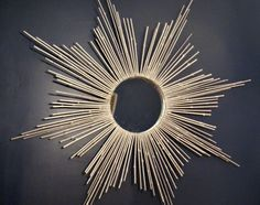 make wall art like this with a circular object, evenly spaced nails in board, and string